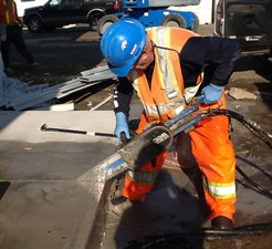 Cutting concrete at target store with concrete chainsaw.